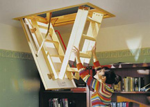 Woman folding a loft ladder